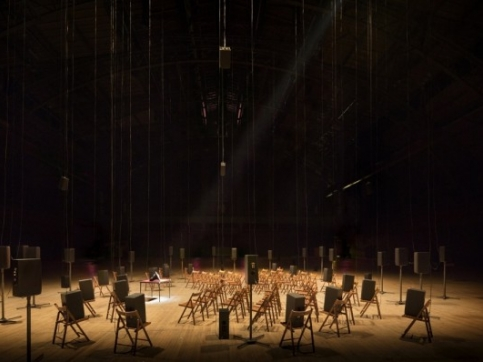 Chairs arranged in a circle facing a speaker