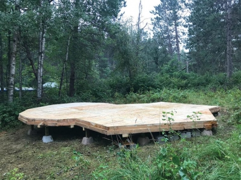 Wood platform in woods