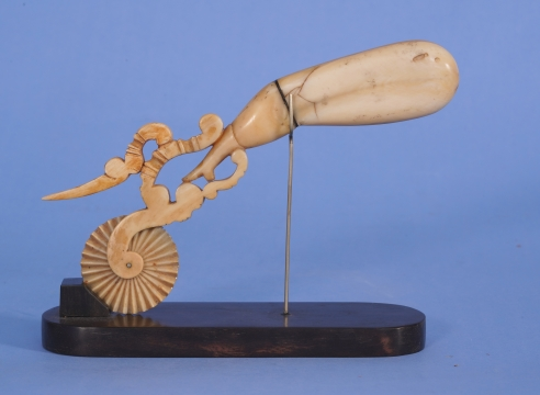 "WHALE IVORY AND BALEEN PIE CRIMPER IN THE FORM OF A ""NAUGHTY LADIES LEG"