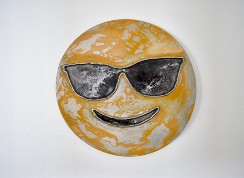 Smiling face with shades