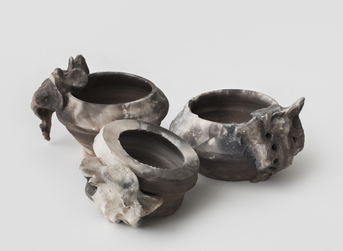 "Alt=""Janine Antoni, Hearth, 2014, Set of three pit fired ceramic"""