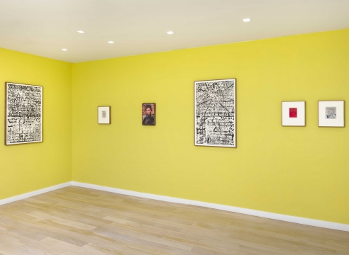multiple rectangular works in a green room