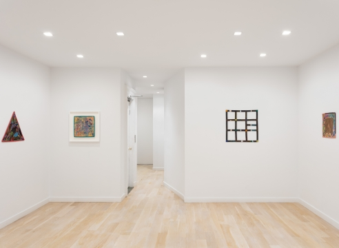 installation view with 4 geometric abstract paintings by Alan Shields