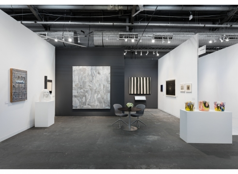 art fair installation view with paintings and sculpture
