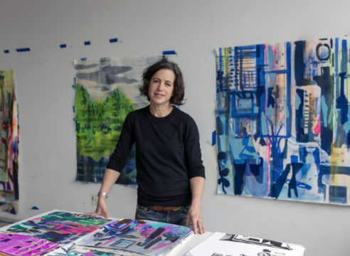 Allison Gildersleeve with her paintings