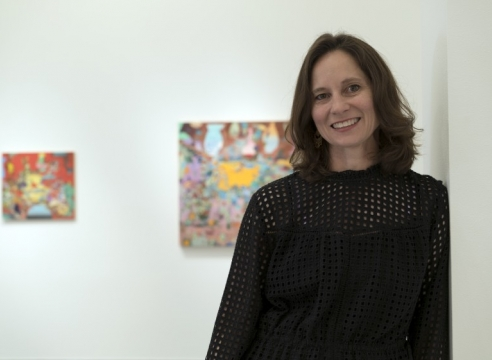 Carolyn Case with her paintings