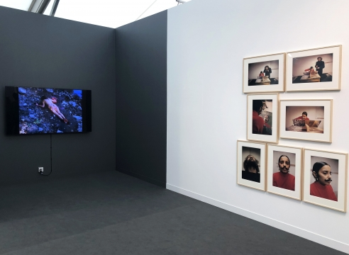Art fair booth featuring video and photographs