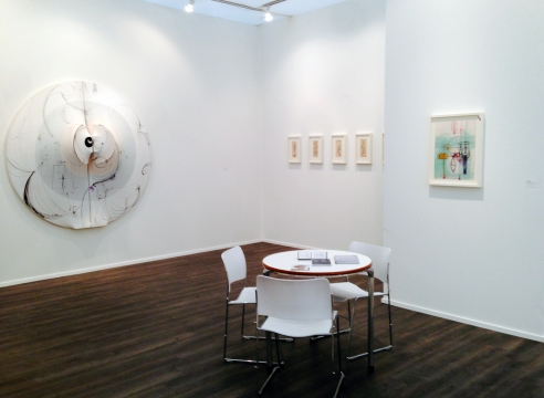Art fair booth featuring works on paper and paintings