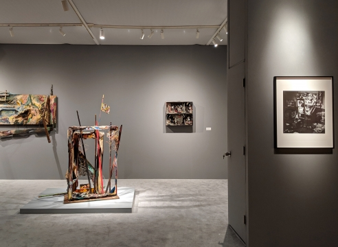 Art fair booth featuring sculpture and paintings by Carolee Schneemann