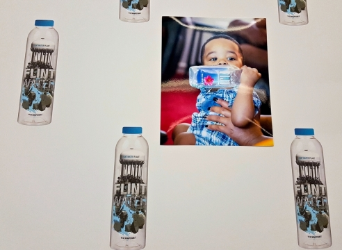 Pope.L's Conceptual Bottled Water Project Calls Attention to the Crisis in Flint