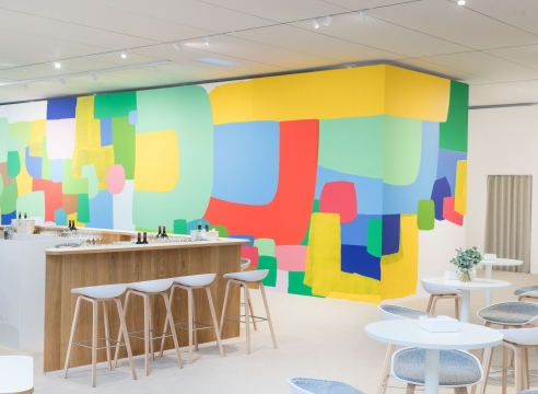 Brightly colored abstract mural by Federico Herrero installed in UBS Lounge