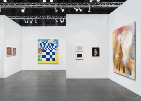 image of a art fair booth with multiple artworks