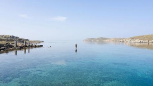 Antony Gormley installs iron figures among ancient ruins on the Greek island of Delos