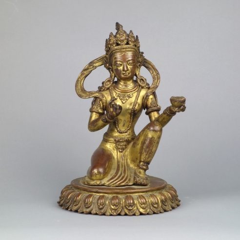 Nepalese Gilt Copper Figure of a Donor Queen