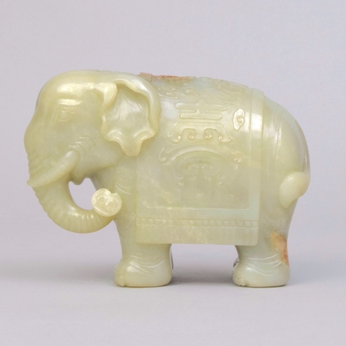 A Celadon and Russet Jade Caparisoned Elephant