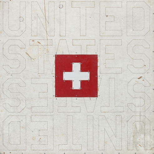 Mixed media on plywood of a Swiss flag over text that reads 'United States' by Tom Sachs
