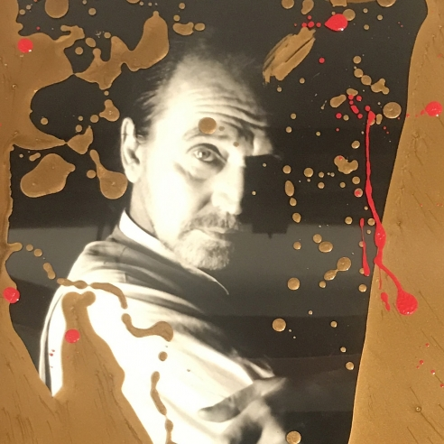 Red and gold portrait of Rene Ricard by Sante D'Orazio