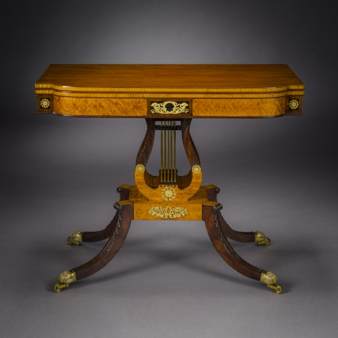 Card Table with Lyre Base, about 1815. Philadelphia. Mahogany, with gilt-brass paw toe caps and castors, strings for the lyres, and gilt-brass and ormolu mounts 28 1/2 in. high, 35 in. wide, 17 1/2 in. deep (at the top), 18 in. deep (at the castors)