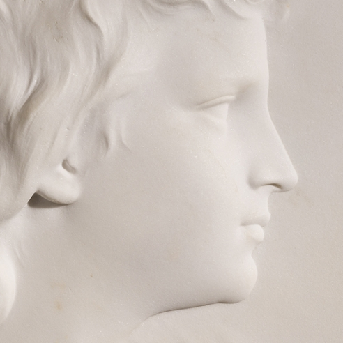 """ERASTUS DOW PALMER (1817–1904), """"Portrait of Walter Launt Palmer (at Age Seventeen),"""" 1871. Marble relief, arched top, 19 x 13 1/2 in. Detail."""