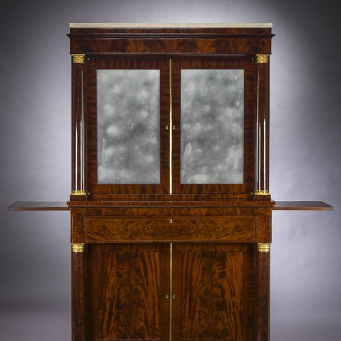Cabinet with Mirrored Doors, about 1820. Attributed to Duncan Phyfe (1770–1854), New York. Mahogany with ormolu capitals and bases, gilt-brass door moldings, keyhole liners, and knobs, marble, and mirror plate, 78 5/8 in. high, 35 in. wide,22 in. deep (overall). Detail.