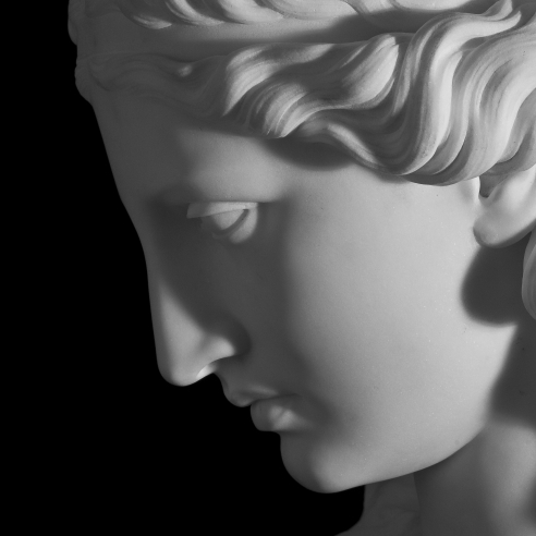 CHAUNCEY BRADLEY IVES (1810–1894), Ariadne, 1861. Marble bust, 31 in. high (moody, shadowy close-up detail of profile of face).