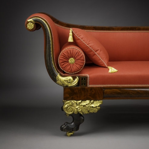 Récamier in the Neo-Classical Taste, about 1820. Attributed to Duncan Phyfe (1770–1854), New York. Mahogany, partially gilded and painted verde antique, with die-stamped gilt-brass mounts, bolster buttons, and castors, and die-stamped brass inlaid with ebony, 32 in. high, 82 3/4 in. long, 24 1/2 in. deep (detail).