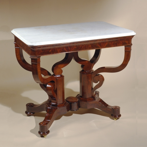 Rectangular Center Table, about 1840. Possibly Duncan Phyfe. New York Mahogany, with gilt-brass castors, and white marble top 31 1/4 in. high, 37 3/8 in. long, 25 7/8 in. wide