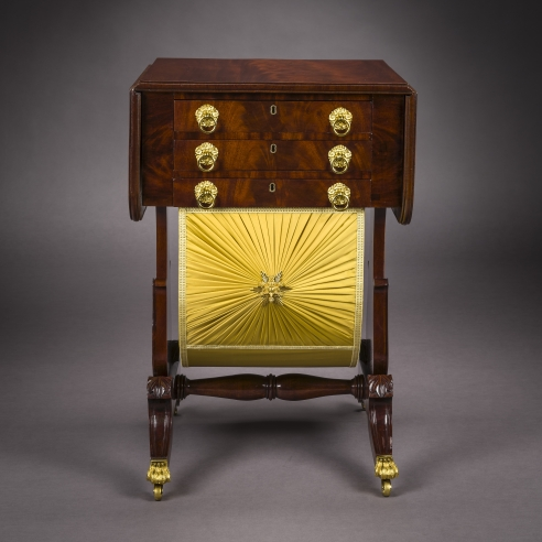 Neo-Classical Drop-Leaf Work Table with Lyre Ends, about 1828–29. Attributed to Rufus Pierce, Boston. Mahogany, with gilt-brass paw toe-caps and castors, drawer pulls, key-hole escutcheons, baize writing surface, and fabric on workbox, 28 13/16 in. high, 19 1/2 in. wide, 20 1/8 in. deep (at the castors)