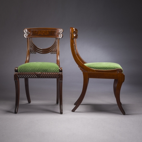 Set of Twelve Klismos-form Dining Chairs, about 1815–20. Attributed to Isaac Vose & Son (active 1819–25), with Thomas Seymour (1772–1848), as foreman (active in the Vose shop, 1819–25), Boston. Mahogany with upholstered slip seats Each: 34 in. high, 18 13/16 in. wide, 23 1/8 in. deep (overall).