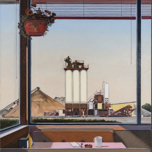 a table in a diner with an industrial landscape through the window
