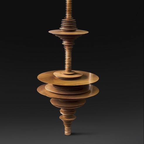 a sculpture by Elizabeth Turk of wood discs stacked and arranged to simultaneously resemble a Modernist abstraction and a sound wave