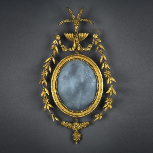 Oval Federal Mirror, about 1800. American, probably New England. Pine and iron wire, gessoed and gilded, with compo ornament and mirror 25 1/2 in. high, 14 1/2 in. wide.