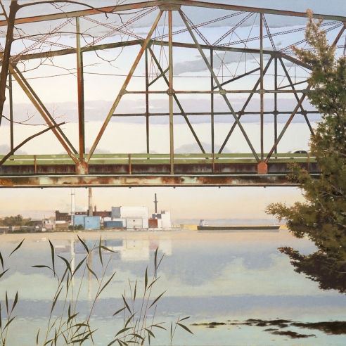a rusting bridge over a river