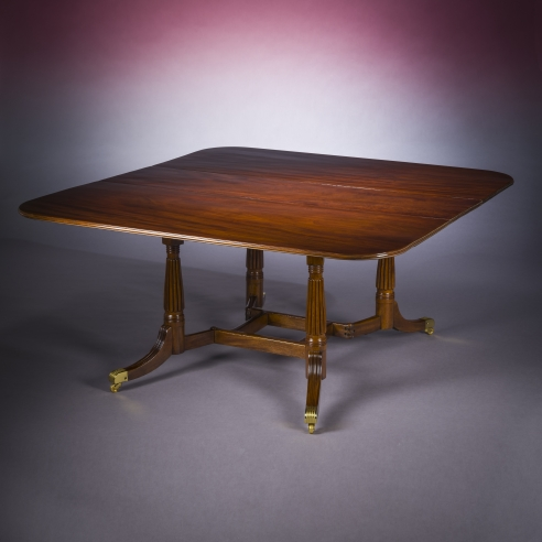 Cumberland-action Dining Table, about 1815–20. Attributed to Thomas Seymour, possibly for Isaac Vose, Boston. Mahogany, with gilt brass toe-caps and castors 28 3/4 in. high, 62 1/4 in. long, 60 in. wide; with leaves down, 17 in. wide, 62 1/4 in. long