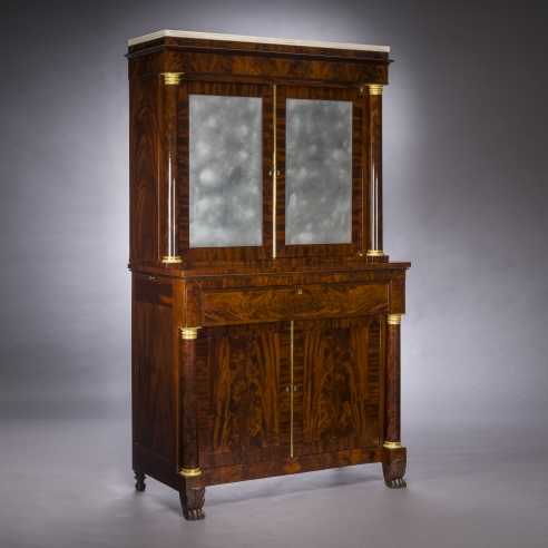 Cabinet with Mirrored Doors, about 1820. Attributed to Duncan Phyfe (1770–1854), New York. Mahogany, with ormolu capitals and bases, gilt-brass door moldings, keyhole liners, and knobs, marble, and mirror plate 78 5/8 in. high, 35 in. wide, 22 in. deep (overall).