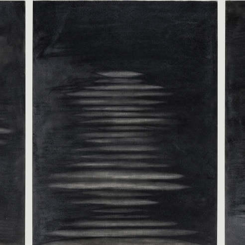 a triptych of abstract drawings by Elizabeth Turk of white discs stacked on each other