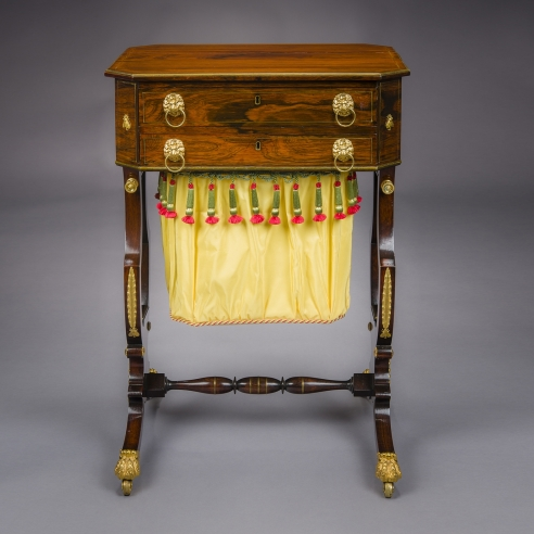 """Neo-Classical Work Table with Lyre Ends,"" about 1815. Attributed to Thomas Seymour (1771–1848), Boston. Rosewood, with brass line inlay and brass-over-wood baguette moldings, gilt-brass and gilt-bronze and ormolu mounts, toe-caps, and castors, and fabric work bag, 29 3/4 in. high, 20 5/16 in. wide, 16 3/4 in. deep"