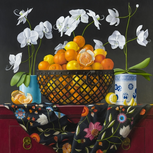 an ornate still life painting of oranges in a metal basket with flowers, vessels, and patterned fabric by James Aponovich