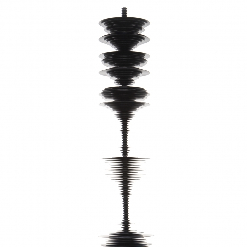 a sculpture by Elizabeth Turk of black aluminum discs stacked and arranged to simultaneously resemble a Modernist abstraction and a sound wave