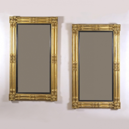 Pair Neo-Classical Pier Mirrors, about 1818. Attributed to John Doggett & Company, Boston, Eastern white pine, gessoed and gilded, with ebonized liners and mirror plate Each, 65 1/8 in. high; 37 1/2 in. wide.