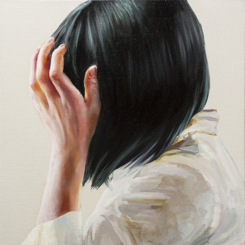 portrait of a woman with black hair covering her face