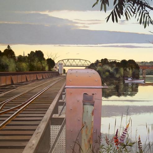 railroad tracks on a bridge over a river