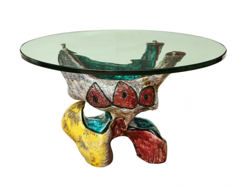Ceramic sculptural low table with round glass top and brass fittings