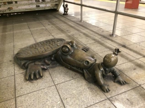 The story behind the strange 8th Ave. subway statues