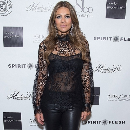Elizabeth Hurley Shows Off Her Body in a See-Through Lace and Leather Getup