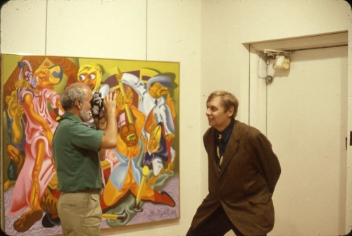 """Robert Arneson and Jack Beal in front of Peter Saul's """"Beckmann's 'The Night, 1918',"""" May 1979."""