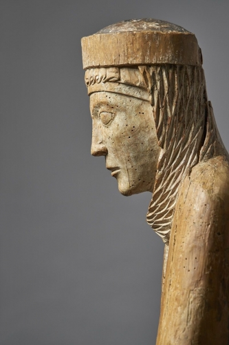 wood sculpture of woman