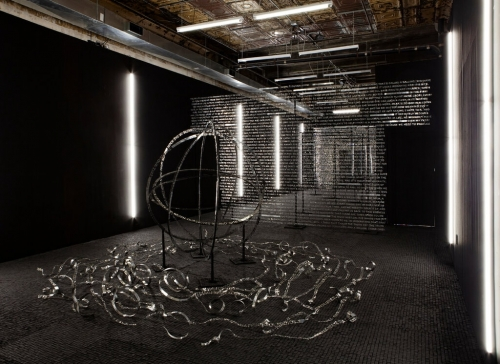 Art installation of metal type and globe