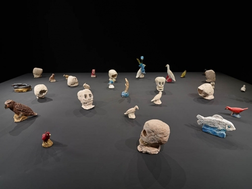 small sculptures arranged on a grey table