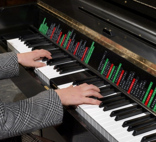The Instrument of Troubled Dreams, hands on piano